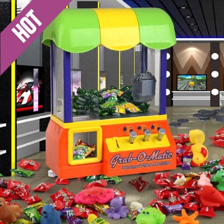 ФОТО Electric crane machine Claw Crane Electronic Candy + 10Pcs doll & Toy Grabber Game Arcade Machine crane game toys