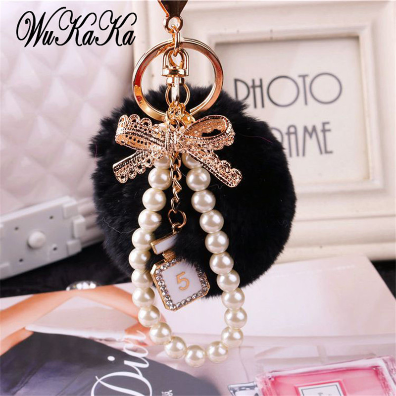 2019 Fashion Pearl Chain Crystal Bottle Bow Pompom Keychain Car Women HandBag Key Chain Ring Fluffy Puff Ball Keychains Jewelry