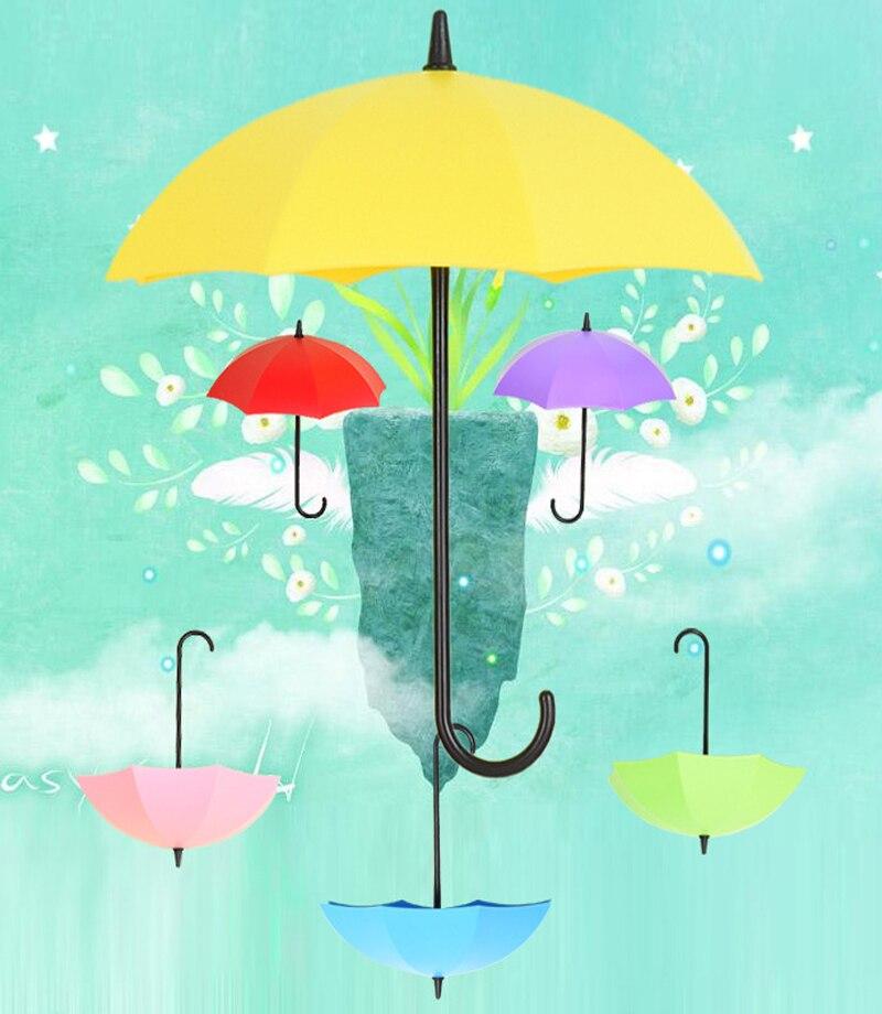 Vihmavarjukujulised konksud  kergete asjade riputamiseks