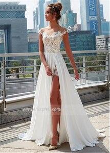 Image 3 - Laço encantador & chiffon sheer jewel decote a linha vestido de casamento com apliques de renda frente fenda praia vestido de noiva