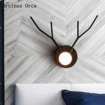 Nordic modern concise staghorn wall lamp living room corridor bedside lamp post-modern creative personality LED iron wall lamp