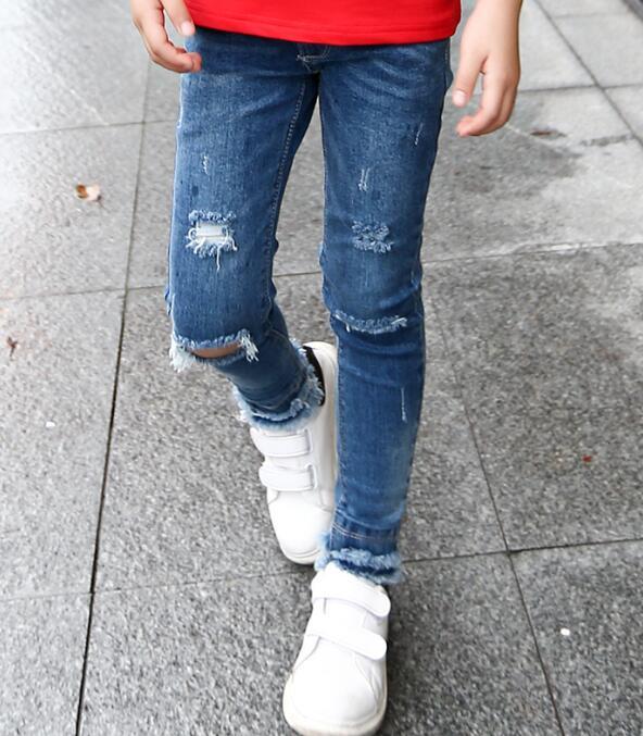 2018 vêtements de printemps enfants filles jeans solide mince trous denim  bleu bébé fille de causalité jeans pour filles grands enfants long pantalon 0d31717e9d64
