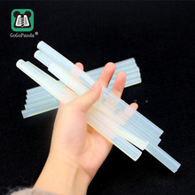 купить Free shipping(10PCS/Lot) Non-Toxic  11mm X190mm Adhesive Craft Sticks Hot Melt Glue Sticks Translucent по цене 175.55 рублей