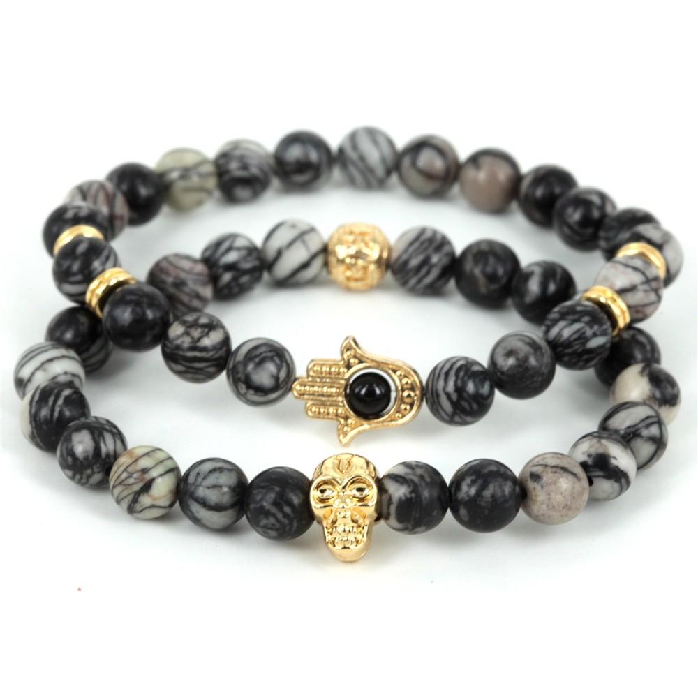 649b3329e0f Venta caliente de la joyería negro lava energía piedra Cuentas oro color  HAMSA pulseras nuevos productos Yoga mala para hombres y regalo de las  mujeresUSD ...