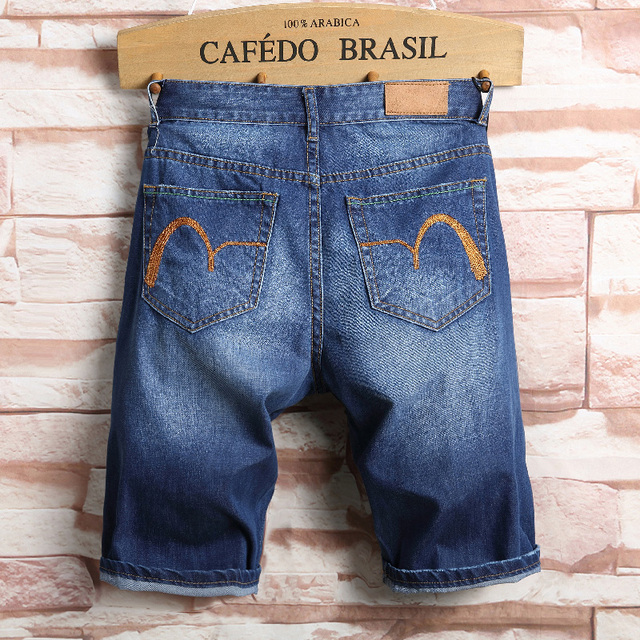 New men's denim shorts Slim straight paint big hole pants five pants simple fashion hiphop comfortable male distressed jeans
