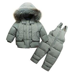 Image 1 - Moda kış erkek bebek giyim setleri 1 3Y erkek kayak takım elbise çocuklar spor tulum sıcak palto kürk ördek aşağı ceketler + önlük pantolon