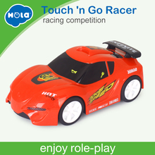 Купить с кэшбэком HUILE TOYS 6106B Baby Toys Touch 'n Go Race Car with Touchable Function & Music & Lights Pull Back Cars Toys for Children Gifts