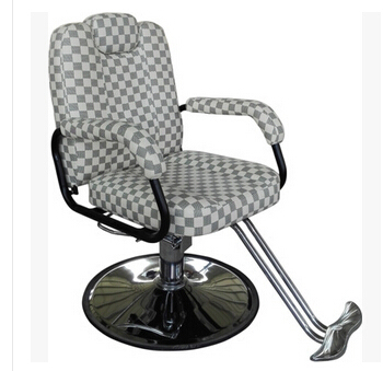Hair salon barber chair. Hairdressing chair. Put down the barber chair.