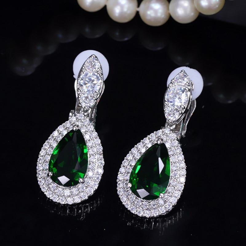 green clip earring