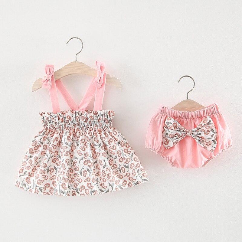 Nowa letnia bluzka z kwiatowymi kokardkami i spodenkami Komplet - Odzież dla niemowląt - Zdjęcie 4