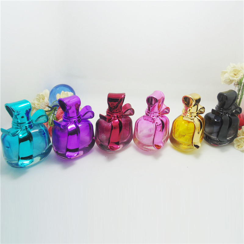 BP 55 Free Shipping 1pcs 15ml UV Bow Cover Perfume Bottles Glass Empty Bottles Mini Ztomizer