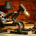 LOFT industrial iron water pipe desk lamp athlete robot lamp retro Sports modeling desk lights dimming table lamp art decor