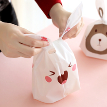 Cute Easter Bunny Cookies Bag 50pcs Wedding Decoration Kawaii Rabbit Ear Plastic Candy Bag Easter Decorations For Home(China (Mainland))