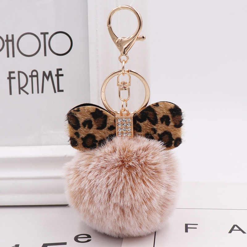 Cristal de moda arco cadenas de joyería de leopardo pompón llavero de peluche de conejo de piel bolso de las mujeres colgantes coche llave anillo