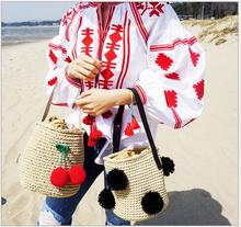 Fashion Women bag. Cool Girl Cherry Pompon Bucket Bag Cylinders Handbag Bohemian Straw Messenger Bags Woven Beach Crossbody