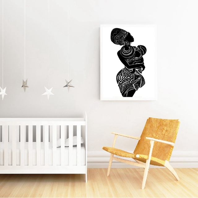 painting of african mother holding baby in nursery room
