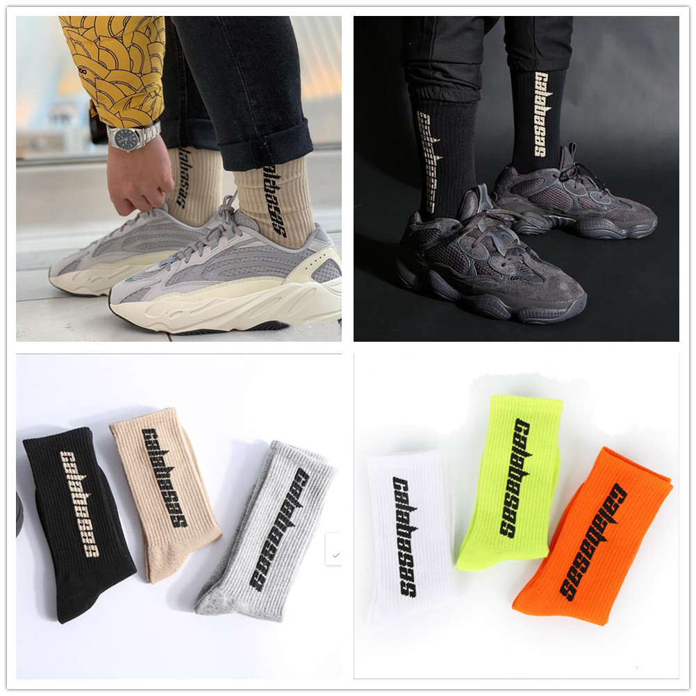 A pair of unisex Calabasas fashion lettering coconut sports   socks   Kanye West with the same cotton   socks   meia