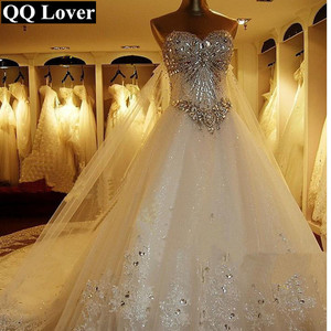 Image 1 - 2020 New Luxury Big Train Wedding Dress Sexy Crystals Beaded Bridal Gown Custom made Plus Size Wedding Gown