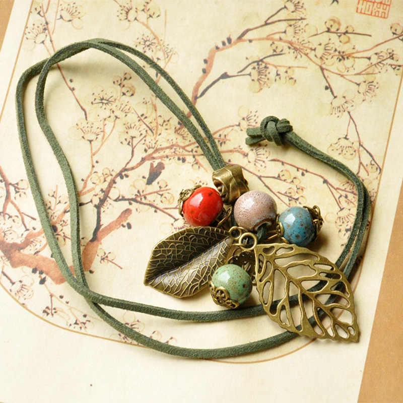 Skórzane naszyjniki wklęsły liść ceramiczne koraliki liście wisiorki Tassel Rose Flower Charm długi sweter Choker łańcuszek kobiety biżuteria