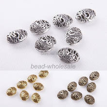 OMH Grosir 10Pcs Antik Tibet Perak Ellipse Berbentuk Hollow Spacer Bead Temuan ZL209(China)