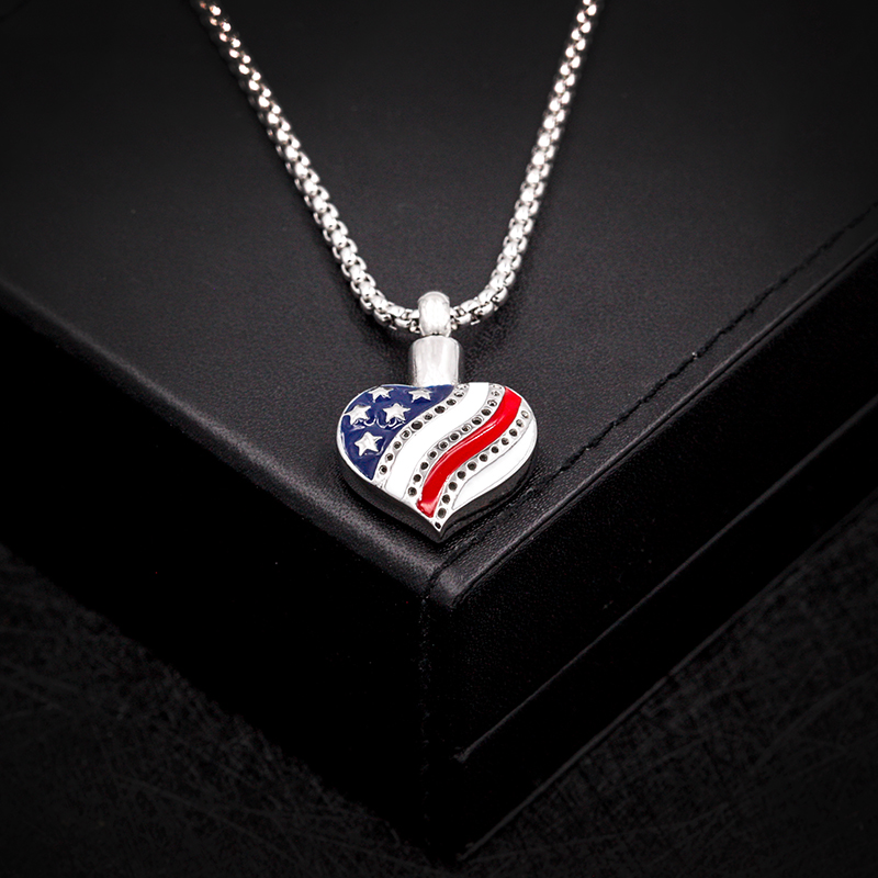 """Heart Shaped US Flag Memorial Cremation Urn For The Ashes Of Your Veteran Or Patriot In Stainless Steel with 24"""" Silver Chain"""