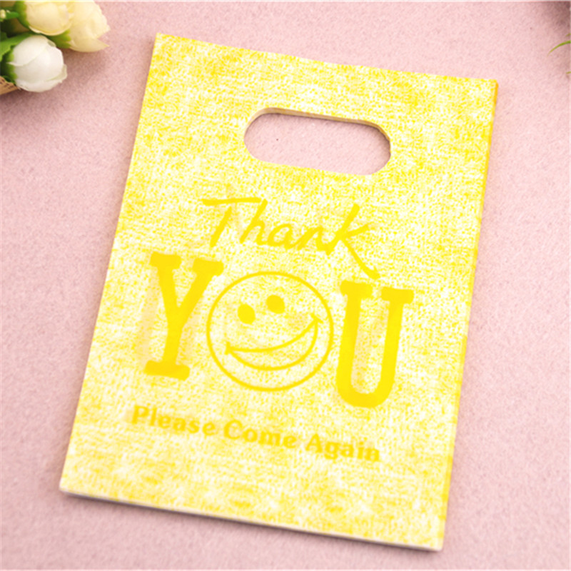 New Design Wholesale 100pcs/lot 13*18cm Yellow Plastic Gift Packaging Bags With Thank You Letter Smile Face Shopping Bags