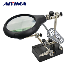 holder with light and magnifying glass