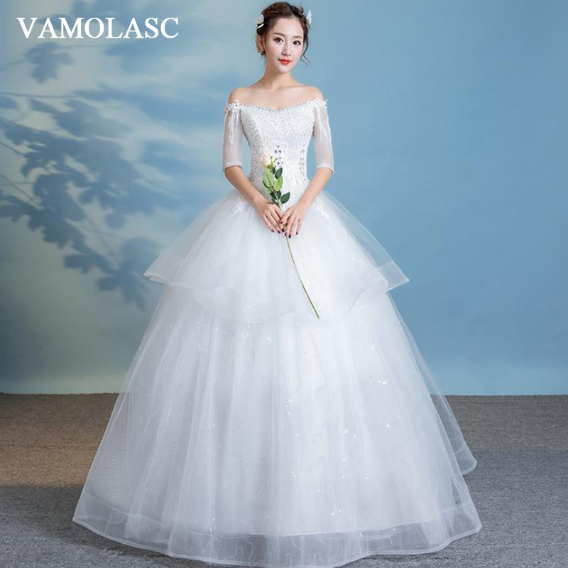 VAMOLASC Ball Gown Tiered Lace Wedding Dresses Crystal Boat Neck Illusion Tassel Half Sleeve Backless Bridal Gowns