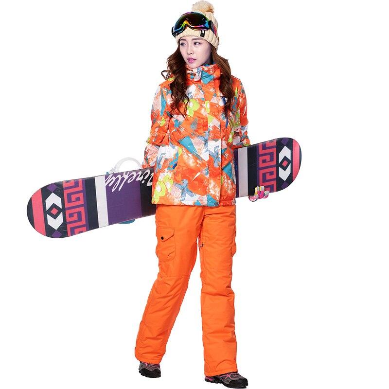 Dropshipping Combinaison De Ski Femmes Hiver Épaissir vêtements De Ski Imperméable À L'eau Moutian Snowboard Ensemble Sangle Pantalon de neige veste et pantalon Femelle