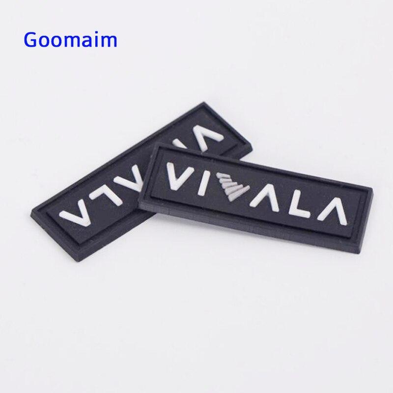 Étiquettes en PVC sur mesure dans les étiquettes de vêtement étiquette de vêtements étiquette de drapeau en caoutchouc lavable pour marque de jeans étiquette de couture en PVC pour chaussures