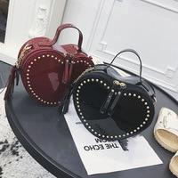 2018 autumn new fashion simple solid color heart shaped crossbody bag patent leather tassel rivet decorative handbag.