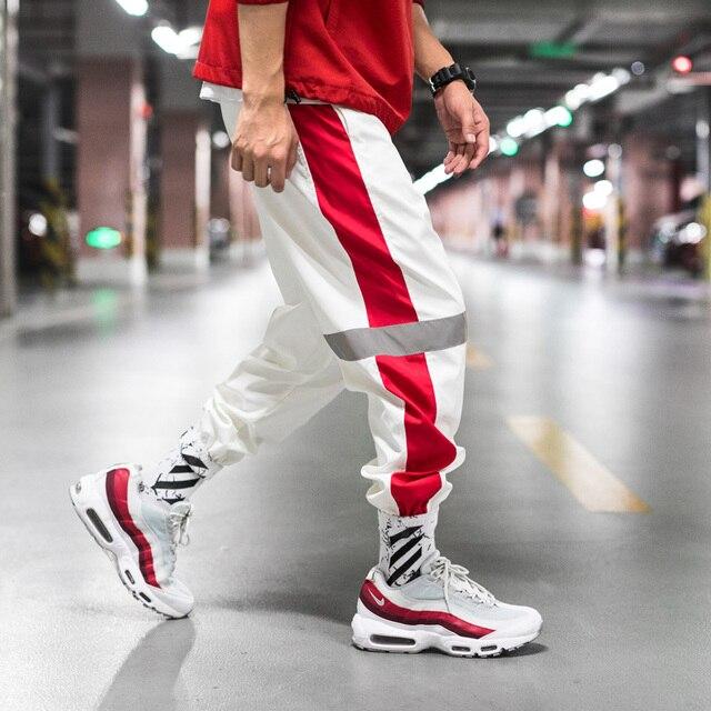 גברים מכנסי טרנינג Loose גברים רצים מכנסיים היפ הופ ספורט מסלול הרמון מכנסיים גברים Streetwear מכנסיים 4XL 5XL