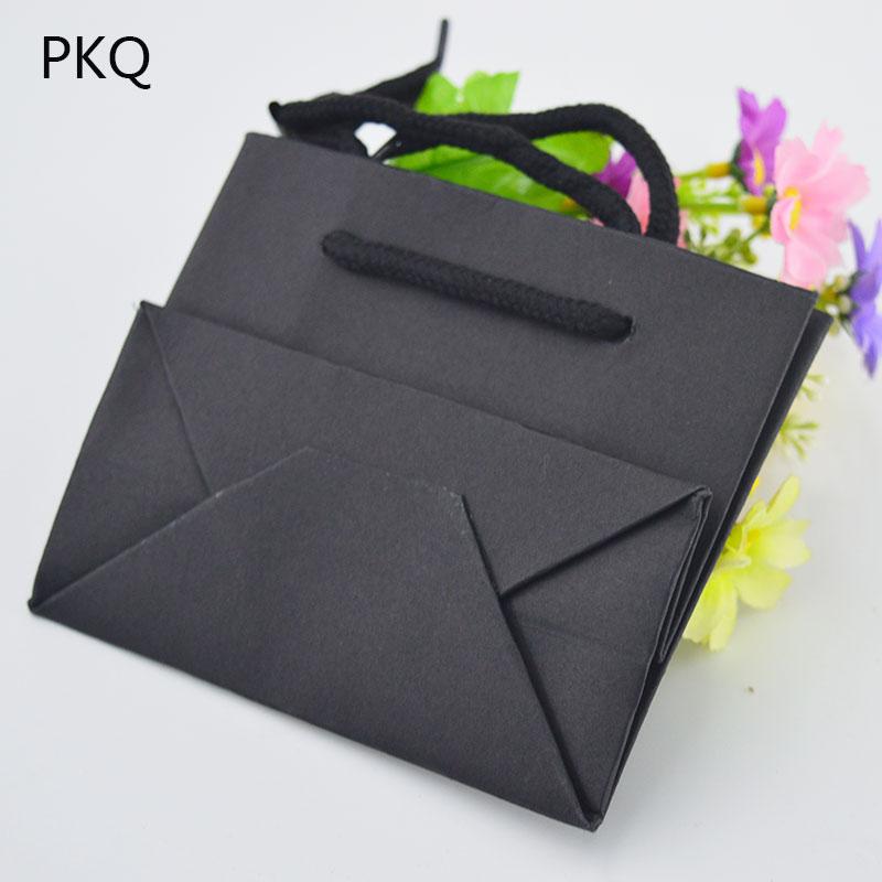 Image 4 - 50 Uds bolsa de regalo blanca de 3 tamaños con asa negra/bolsa de  papel Kraft marrón para empaquetar bolsas pequeñas de joyería Rosa  bolsa de fiesta regaloEnvoltorios y bolsas de regalo