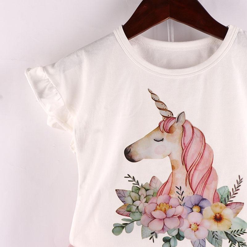 0b8dac857 Trajes para niños Niñas Ropa conjunto 2018 nuevo unicornio mágico patrón  blanco camiseta falda de encaje lindo desgaste de los niños 3 7Y en  Sistemas de la ...