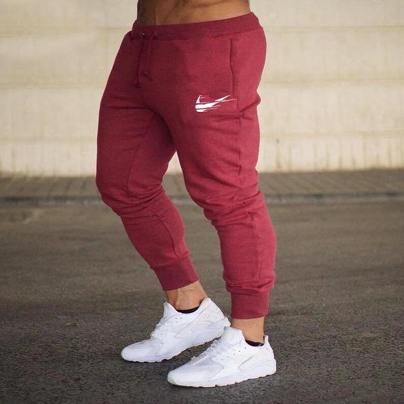 Model Print brand Gyms Males streetwear Informal Males Sweatpants Joggers Pantalon Homme Trousers Sporting Clothes Bodybuilding Pant Sweatpants, Low-cost Sweatpants, Model Print brand Gyms Males streetwear Informal Males Sweatpants...
