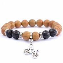 764c0bd75c42 Moda bicicleta encanto pulseras hombres piedra Natural madera Jaspers  cuentas pulsera y brazalete para las mujeres amistad joyer.