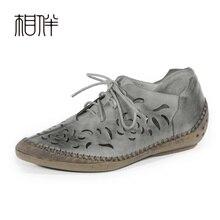 Desinger de la marca mujeres de los planos zapatos ocasionales del cordón de las señoras transpirable zapatos de cuero ahuecan hacia fuera el viento nacional