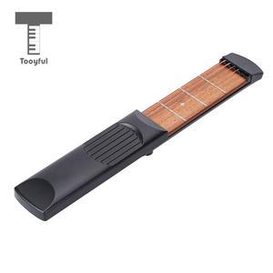 Image 4 - 4 Fret 6 dizeleri sağ Handed cep gitar seyahat gitar seti acemi çocuklar uygulama aracı parmak egzersiz müzikal enstrüman