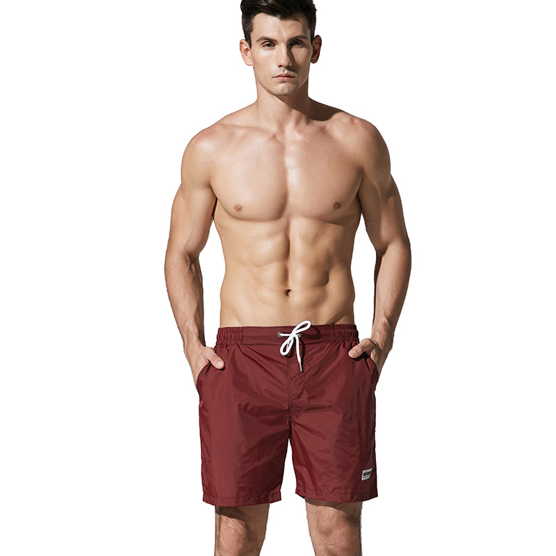 2018 DESMIIT beach pants loose pure color holiday 4 points tide seaside shorts male quick dry swimming shorts Comfortable