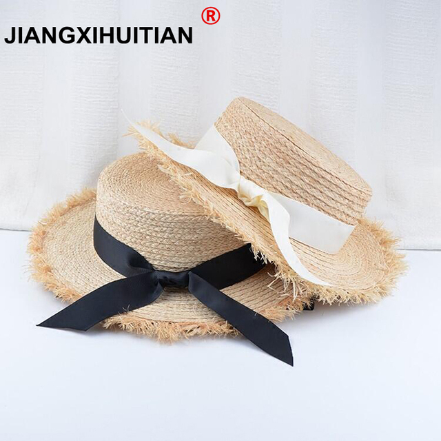 2b51a984c9a 2018 New summer bow 100%Raffia hat Temperament flat Straw hats Women s Sea  beach vacation leisure sunscreen hat