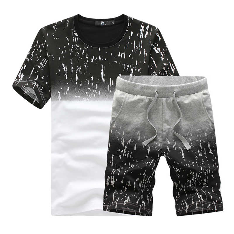 2018 ファッション夏 Casaul スーツセット男性は Tシャツ + パンツフィットネスメンズショートスーツ 2 ピースセット男性半袖トップス