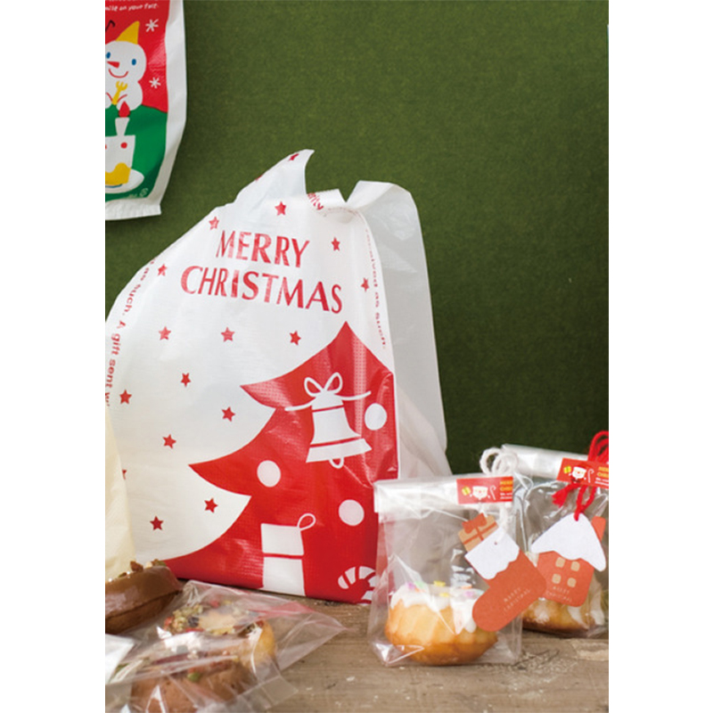 100pcs/lot Size 18*35cm(7*14) Christmas decoration package gift bag Shopping plastic Bag with handle house picture bag