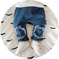 2017 Nueva llegada de la manera pantalones vaqueros del bebé parche rodilla infantil chicos niñas de alta calidad ropa de los niños Pantalones de Mezclilla para niños de dibujos animados
