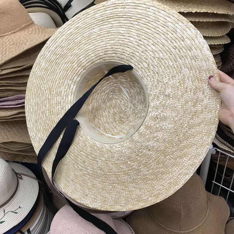 النساء قبعة صيفية 15 سنتيمتر كبيرة حافة قبعة الشمس سطح مسطح شريط أسود حبل الرياح الكلاسيكية قبعة ستو مكافحة الأشعة فوق البنفسجية قبعة قبعة الشاطئ الكبيرة