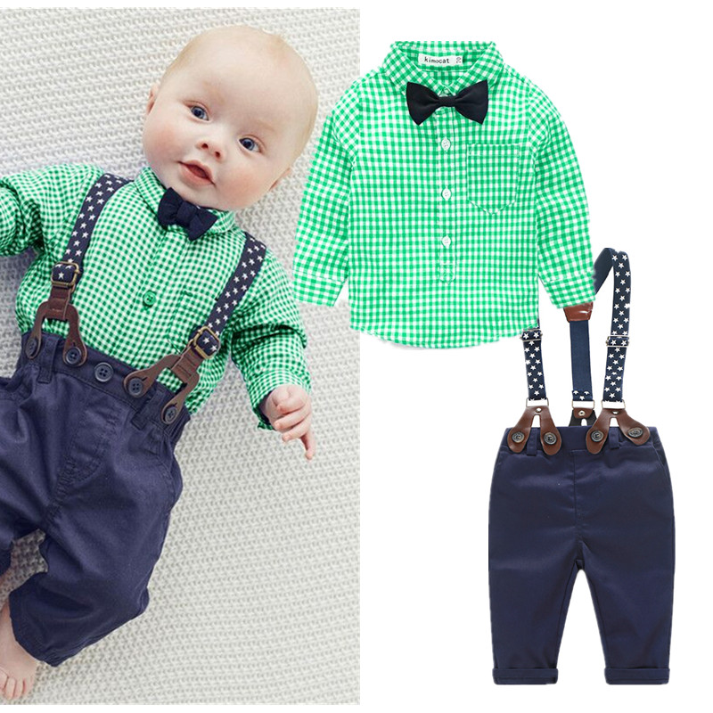 Polo Ralph Lauren baby boy's light weight cotton flannel plaid shirt. Plaid is red, hunter green, cream, black, and yellow. Buttons down the front and button arm cuff.