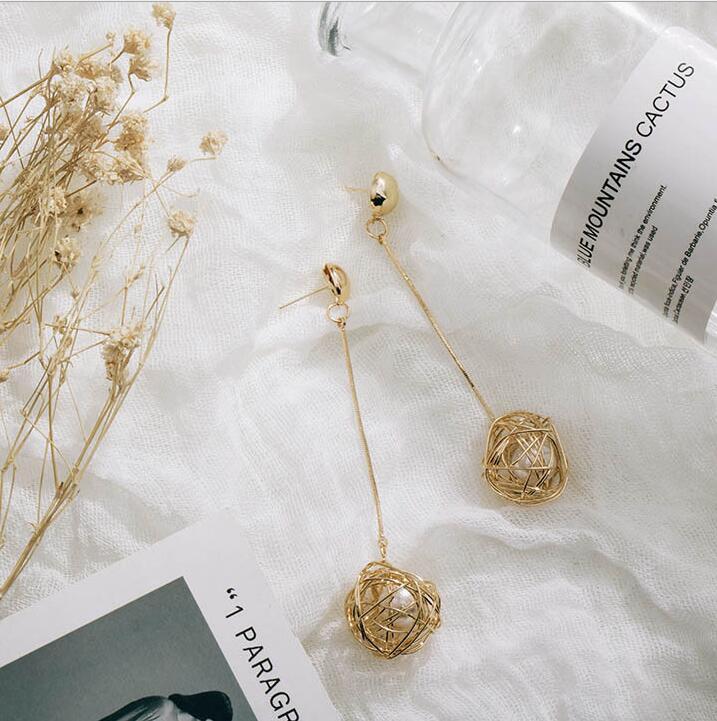 Brand Hollow Bird Nest Drop Dangle Earrings Long Paragraph Cold Wind Ladies Big Pearl Earrings Female Hypoallergenic Earrings in Drop Earrings from Jewelry Accessories