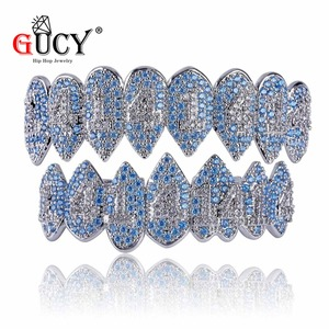 Image 2 - GUCY Iced Out Hip Hop 1414 Teeth Grillz Bling AAA Cubic Zircon Silver Color Eight Top & Bottom Vampire  Grills Set For Gift