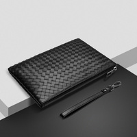 The new head layer cowhide leather handbag woven envelopes bulk clutch bag hand bag leather business