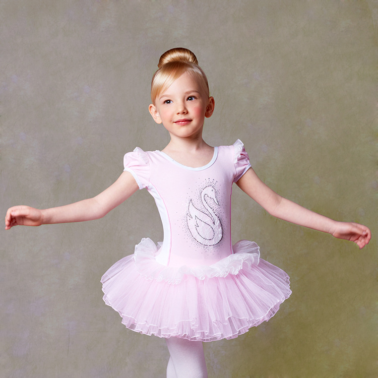 Girls Ballerina Ladybug Costume features a dress with ladybug print, long black sleeves, and a daisy brooch with a faux ruby at the center of the neckline. A red tutu skirt with three tiers of tulle trimmed with black satin is attached.