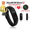 En stock original xiaomi miband 2 mi banda 2 de la aptitud Pulsómetro rastreador Bluetooth 4.0 Pantalla OLED Touchpad Para Android